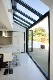 Glass roof and walls with glazing bars running through in line.  Huddersfield Kitchen Extension by Architecture in Glass by AproposUK,