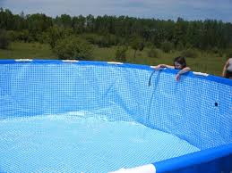 intex above ground swimming pool. With An Inch Or Two Of Water In The Intex Swimming Pool, You Should Carefully Smooth Out Any Wrinkles On Bottom Liner Your Feet Hands, Above Ground Pool N