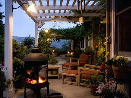 backyard patio ideas awesome patio decorating ideas with brown wooden long chairs also black iron fireplace backyard patio ideas
