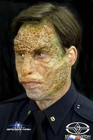 neither sun damage nor virus but simply the makeup skill of bill corso was responsible for applying the legacy effects reptilian prosthetics in the amazing