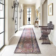 a traditional style best hallway runners rug in a rustic space with paved floors and plastered