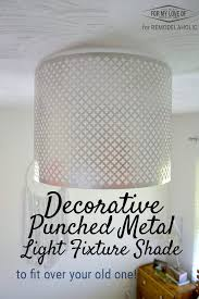 dress up a basic builder grade light with a diy punched metal ceiling light shade
