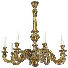 french baroque style chandelier in carved wood with eight lights circa 1910