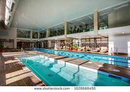 indoor gym pool. Upscale Indoor Swimming Pool With Swim Lanes And 2 Level Gym In Condominium Complex.