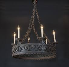 french late 19th century iron gothic revival chandelier with six dark bronze lights attached to the reticulated round wrought iron center ring