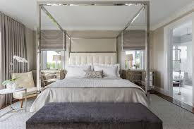 chrome canopy bed with beige upholstered headboard bedroom ...