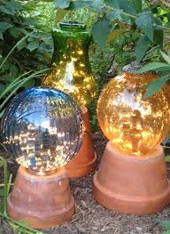 diy garden lights made from flower pots and old lamp globes outdoor lighting ideas projects