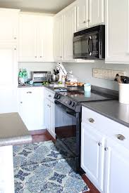 how to paint kitchen cabinets without fancy equipment i didn t even sand the