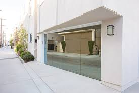 wayne dalton unveils a revolutionary new full view aluminum door model 8450 otherwise known as luminous is modern stylish and ever so sleek glass panels