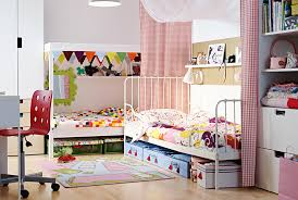 Kids' shared bedroom. Two IKEA beds in an L-shape with fabric room