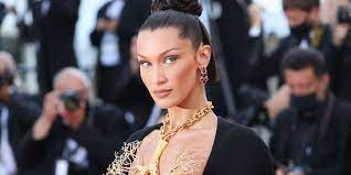 Bella Hadid wears golden lungs necklace ...