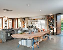 prefab concrete farmhouse massive cypress slab table and salvaged branch crystal chandelier