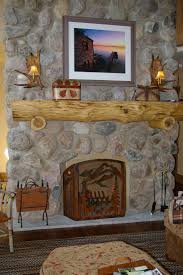 interior design large size stacked stone fireplace freestanding rustic faux brick siding fronts wall rocks