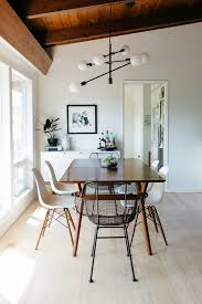 mid century expandable dining table. A Mid-Century Expandable Dining Table From West Elm Is Flanked By Four Eames Molded Mid Century