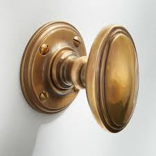 edwardian oval door knobs antique satin brass broughtons lighting ironmongery