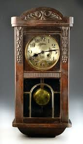 antique wall clocks with pendulum antique pendulum wall clock carved arching and walnut case with beveled and leaded glass window antique pendulum wall