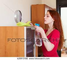 dusting furniture. Stock Photography - Woman Dusting Wooden Furniture With Rag And Cleanser .  Fotosearch Search G