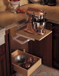 an appliance lift rises from a base cabinet and locks into place while you work