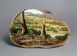 Artist paints sublime landscapes onto salvaged logs