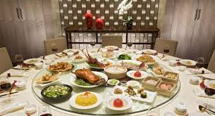 tables for large groups are almost always round which comes from the tradition of sharing dishes amongst large groups of people with a round table