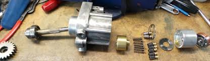 pictures of heui hpop disassembly for international navistar above left to right gear shaft main bearing pump housing steal valve seat still inside brass cylinder core piston springs pistons