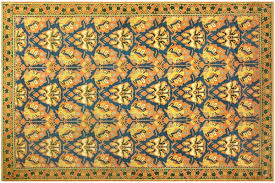 large spanish rug with deep gold tones and blue patterns popular in the 1930 s nazmiyal