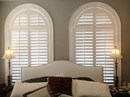 Arched plantation shutters by The Louver Shop make a great backdrop for  this master bedroom. Arched Window CoveringsArched ...