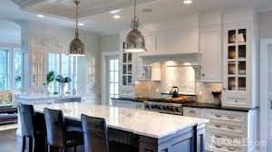 in this kitchen absolute black perfectly compliments a gorgeous statuario marble island