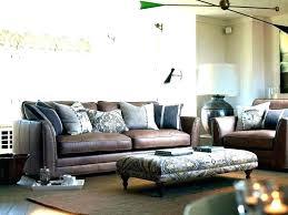 brown sofa with throw pillows