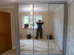 Mirror Closet Doors For Bedrooms 3 Panel Sliding Mirrored Closet Doors Closet Storage Organization