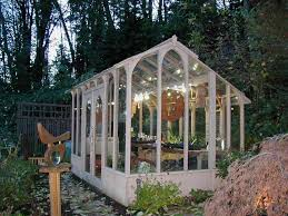 image of contemporary glass greenhouse kits