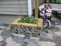 Mosaic scraps mortared to cinder-block planter box...on mosaic mortared to
