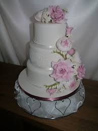 3 Tier Wedding Cake With Pink And White Garden Flowers Cascade