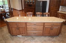 medium stained hickory island quartz countertop