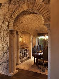 style dining room paradise valley arizona love: this stone archway provides a memorable entrance into this italian style dining room the shape of the entryway the classic style of the dining table and