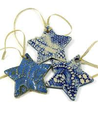 Handmade Ceramic Christmas Ornaments. These beautiful stars were made using  vintage cookie cutters on white