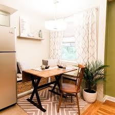eating nook furniture. A Comfortable Breakfast Nook With Stained Wooden Kitchen Table, Storage Bench Seat Eating Furniture