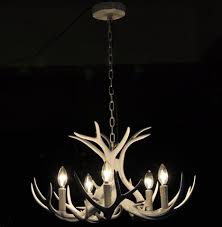 antler chandeliers and chrome metal chain smlfimage source