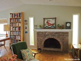 sophisticated paint colors that go with red brick fireplace