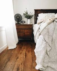 neutral bedroom with dark wooden floors