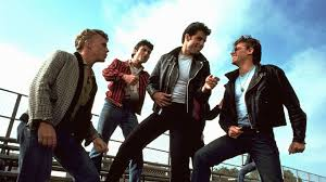 john travolta was one of the celebrities to rock the leather jacket style on the grease
