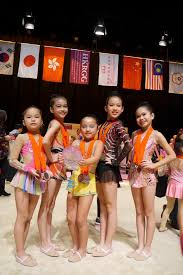 sarawak gymnasts posing with their trophy and medals at the hong kong invitational rhythmic gymnastics chionships in december last year