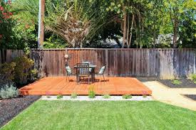 Here's another simple, minimalist floating deck design. The bright wood  stain helps it stand