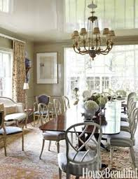 high gloss walls painted in donald kaufman color s dkc a georgian style gany table from florian papp is surrounded by deangelis fret back chairs with