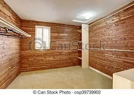 empty walk in closet. Empty Walk-in Closet With Wooden Walls And Carpet Floor. - Csp39739902 Walk In