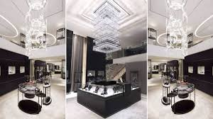 montblanc flagship singapore ion orchard corporate identity staircase chandelier curved laminated glass panels painted with swarovski jewellery