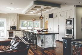 a notable element in the open concept kitchen is the coffered ceiling which acts