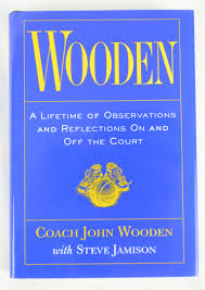 john wooden autographed wooden hardcover book