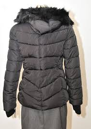 the warmth and comfort of this stylish puffer coat from guess is enhanced with a chic faux fur collar