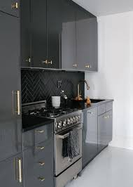 gray lacquer cabinets with gold pulls